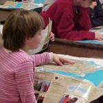 girl-reads-visitors-guide_w725_h544